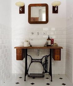 Old singer sewing machine turns to bathroom sink pedestal.