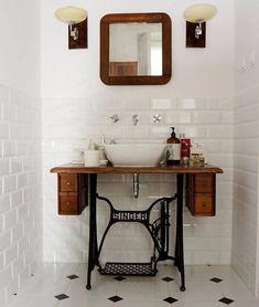 Old singer sewing machine turns to bathroom sink pedestal.