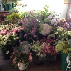 a wedding cut and ready to be turned into table centres, bouquets, buttonholes, chair backs... by www.commonfarmflowers.com