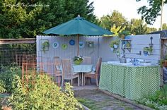 outdoor dining area in the garden | Cottage at the Crossroads Such a pretty little nook in the garden.  Lots of great inexpensive ideas on this blog.