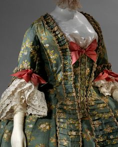 18th century opulence in fashion. Note the excessive trims and lace!