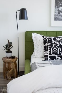 Modern master bedroom before and after using products from EQ3 and SAM Design. Marimekko pillows, pattern bedding, green bed, teak stools.