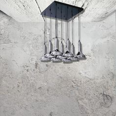 E2 Contract Lighting | Products | 9 Light Modern Chrome Chandelier CL-32505 | Modern Chrome Chandelier, 9 chrome hanging lights from a black ceiling plate.