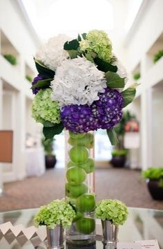 Green, purple, and white #hydrangeas make a modern flower arrangement. #wedding (Photo by: Captured Photography By Jenny)