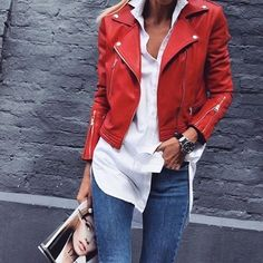 Cute red leather jacket over white shirt and blue jeans.