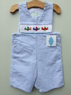 Baby Boys Smocked Airplanes Jon Jon MBL 2 by Lambs in Ivy Traditions MARKET NEWBIE! Price: $34.99 Options: 2T, 18M  To purchase comment Sold, Size, and Email Address!  Then connect here: https://www.soldsie.com/pin/661111 www.lambsinivy.com