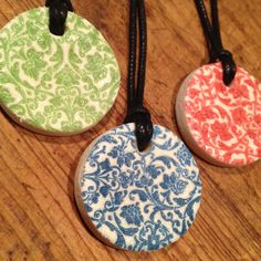 Hand stamped salt dough and air dried clay pendants.