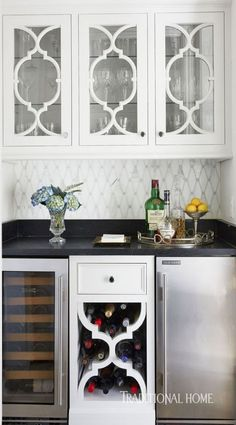 Fretwork adorns cabinets in the pantry space between the kitchen and dining room. - Photo: Jean Allsopp / Design: Dana Wolter Like door fronts Traditional Kitchen, Traditional House, New Kitchen, Kitchen Decor, Kitchen Centerpiece, Centerpiece Ideas, Location Villa, Glass Cabinet Doors, Custom Cabinet Doors