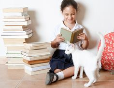 """Why I Ask My Kids to Read to My Cats 