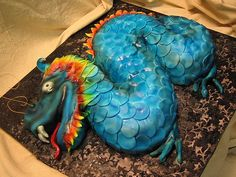 I had the same idea for using fondant circles for a dragon cake.  The color is airbrushed, though, which is a tool I don't have.