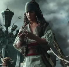 Pre-mustache: His costume is pure Jack Sparrow and he has on a scarf and long hair, but he is clean shaven and thinner