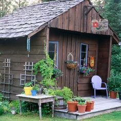 Country Flavors. Give your garden shed country appeal. Barn-board siding, cedar shake shingles, and rustic wooden trellises set the tone. A sunny stoop provides the perfect place to grow herbs and tomatoes in pots. This would be great in a country garden.