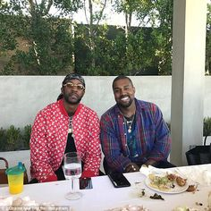Happy: Normally stony-faced, Kanye West was all smiles as he posed alongside hip hop artist 2 Chainz at a lunch organized by Kim Kardashian on Sunday