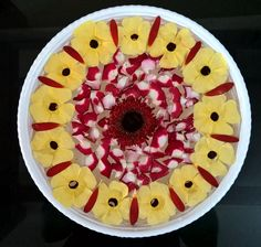 Rose petals n yellow flowers over white bowl..