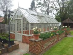 Bespoke, freestanding greenhouse in Wood Sage.