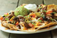Gather around a McAlister's table for some good times, good conversation and loads of nachos. Copycat Recipes, Beef Recipes, Vegetarian Recipes, Resturant Menu, Mcalister's Deli, Ultimate Nachos, Mexican Entrees, My Favorite Food, Favorite Recipes