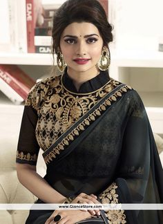 Buy bollywood style saree suit online to look like a true fashionable diva. Gilded Prachi Desai faux chiffon embroidered and patch border work classic designer saree for festival, party and wedding. Cotton Saree Blouse Designs, Saree Blouse Patterns, Fancy Blouse Designs, Designer Blouse Patterns, Trendy Sarees, Stylish Sarees, Designer Sarees Wedding, Saree Wedding, Stylish Blouse Design