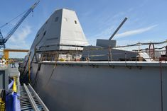 USS Zumwalt The forward and after decks are lined with vertical launchers able to handle a variety of missiles. The deck-edge scaffolding here is just outside the launchers, which are embedded in the side of the ship. Royal Navy, Us Navy, Uss Zumwalt, Fleet Week, Sticks And Stones, Scaffolding, Aircraft Carrier, Small Towns, Warfare