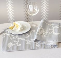 Guests will be ready for everything you set before them on the Pier 1 Scrolling Vine Embroidered Table Runner