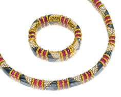 HEMATITE, TOURMALINE AND DIAMOND NECKLACE AND A BRACELET, BULGARI.  The articulated collar composed of cylindrical links set with hematite and brilliant-cut diamonds, spaced by faceted tourmaline rondelles, length 390mm, and a bracelet of matching design, length 170mm, mounted in yellow gold,  signed Bulgari, Italian assay and maker's marks.