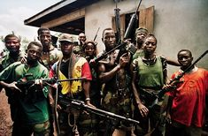 Rebel fighters of the Revolutionary United Front gave themselves names like Baby Killer an...