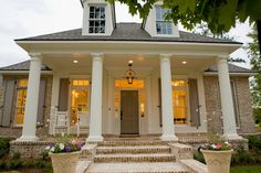 Traditional Front Porch traditional exterior- front door & shutters - Sherwin Williams - Keystone Grey, Columns & Stucco - Pearly White, Brick - possibly Nantucket by Triangle Brick Company or Brick-old Orleans by Cherokee, Mortar - Ivory Buff.