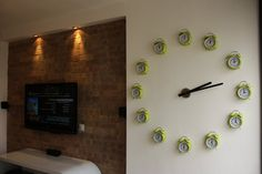 how brilliant is this?!  a giant wall clock with alarm clocks as numbers. #diy #interiordecor #industrial #exposedbrick #design #wallclock