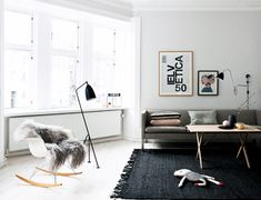 France and son was inspired by the design of this living room. Adding the shades of grey really sets the tone, it balances the black and white in the room.