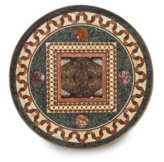An Italian Neoclassical style gilt bronze-mounted faux marble decorated, ebonized and pietra dura-inlaid center table third quarter 19th century height 32 1/2 in.; diameter 36 in. 83 cm; 91 cm