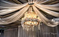 The chandelier at the Ruthe Jackson Center was decorated with florals and drapes to create a garden world feeling.