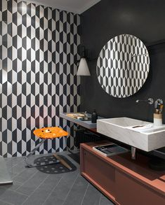 May Day by Konstantin Grcic for FLOS matches this bathroom's funky aesthetic: with patterned walls, a cricular mirror and colorful accents, May Day adds a sophisticated touch.
