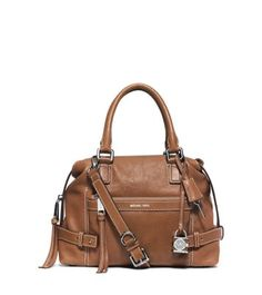 A rich mix of hardware and heritage details characterize this sumptuous leather satchel, sealing its high-style status. This must-have bag features organized pockets and a roomy interior, ensuring it's as functional as it is chic.