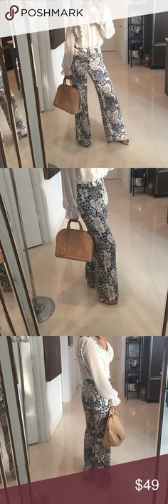 Royal Blue and Gold Print Pants Size S Be that style icon and statement making fashionista in this soft flowy wide leg pants! Pants