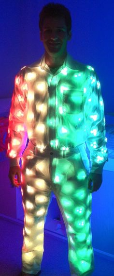 """iPhone controlled light up LED suit - wowzers! Reminds me of Peter Gabriel at the end of the """"Sledgehammer"""" video LOL...like walking/talking stars...would be magical for Burning Man or Electric Daisy Carnival..."""