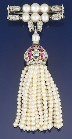 A belle epoque diamond, seed pearl ruby tassel brooch  Designed as an old brilliant and rose-cut diamond pierced floral crown drop with calibré ruby detail and diamond and pearl surmount, suspending a seed pearl tassel fringe, suspended from a cultured pearl and rose cut diamond bar brooch, circa 1910, brooch fitting adapted, please note that the pearls have not been tested for natural origin