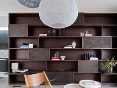This post-industrial bookshelf and storage unit provides a traditional feel in this contemporary home