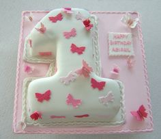 A little girl's first birthday cake.
