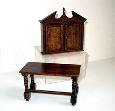 Secretary Cabinet with Writing Table, Dollhouse Miniature 1/12 Scale, Hand Made Does the head of the household in your dollhouse need a place for correspondence or taking care of the manor accounts and daily business? This handsome 2-piece set should fill that need and look good doing it. The cabinet top has 2 shelves and several cubbyholes for storage. The table is just wide enough for writing tasks. This is a one-of-a-kind miniature. This is one inch scale size. The cabinet top is 4 ...