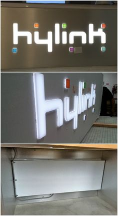 Amazing push-thru desk sign we made for Hylink.  They wanted an impressive way to display their logo for their new Los Angeles office.  To make the sign part of the desk, we created a custom made encloser to encase all of the wires and the power supply that we installed behind the desk.  #signage #signs #resource4signs