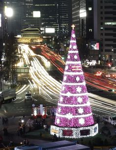 The Most Over-The-Top Christmas Trees Of 2014 | A 69-foot-high Christmas tree is lit to celebrate the upcoming Christmas season at Seoul City Hall Plaza, South Korea, Saturday, Nov. 29, 2014.