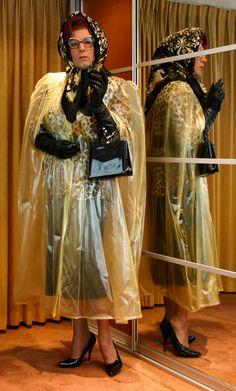 Mrs Wanda Nylon in plastic cape, silk headscarf and leather gloves