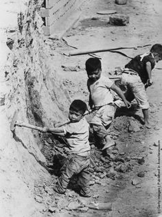 Children working in a clay pit to provide raw materials for a brick factory in Mexico City. (Photo by Central Press/Getty Images). 1970