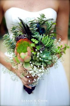 wedding bouquet with succulents and peackock and brooches | succulent-bouquet-peacock-feathers