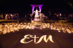 "The couple's signature ""E + M"" monogram featuring a cross was projected onto the dance floor at their poolside wedding reception. Photography: Jason and Rebecca Walker for Ira Lippke Studios Beach Wedding Centerpieces, Beach Wedding Reception, Reception Decorations, Wedding Bells, Photographer Humor, Wedding Music, Dance The Night Away, Wedding Inspiration, Wedding Ideas"