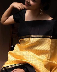 --- Featured in a yellow kanjivaram saree with a solid body that has the classic checks enclosed by a bold charcoal black… Kanjivaram Sarees Silk, Indian Silk Sarees, Kanchipuram Saree, Saree Blouse Neck Designs, Fancy Blouse Designs, Trendy Sarees, Stylish Sarees, Tulsi Silks, Saree Color Combinations