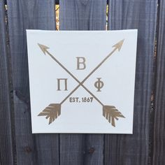 This luxe canvas is hand painted in ivory and gold acrylic, featuring arrows, the greek letters for Pi Beta Phi, and Est. 1867 for the year the