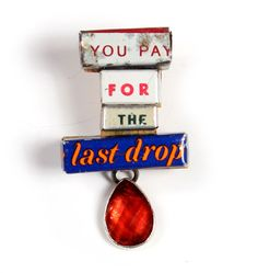 Kat Cole  Brooch: You Pay for the Last Drop  Tin, found objects, brass, steel