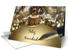 spanish christmas message on golden ornament card:   Created from an original Studio Porto Sabbia photo! This Golden Ornament card is available in different languages. Text: Merry Christmas in the language of your choice!