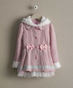 This pretty coat is dressed up with bows, tulle and a detachable hood with fun little ears. Soft fleece lines the hood and trims the cuffs.
