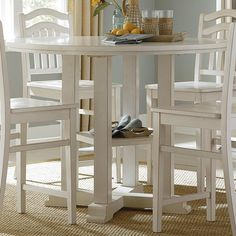 Create a fresh breakfast nook with a counter height pub table.